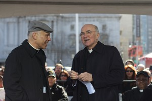 Archbishop Vigano, right,  shares a laugh with Archbishop Cordileone before the rally, while the Rev. Childress prepares. Photo: Darwin Sayo.