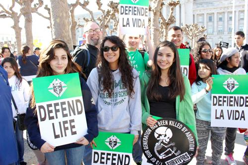 From left, Dorian Salas, Sophia Lopez and Destiny Alvarado from Reedley were part of the 450-person contingent representing four local communities at the Jan. 24 rally and march.  Danny Vasquez / Contributed
